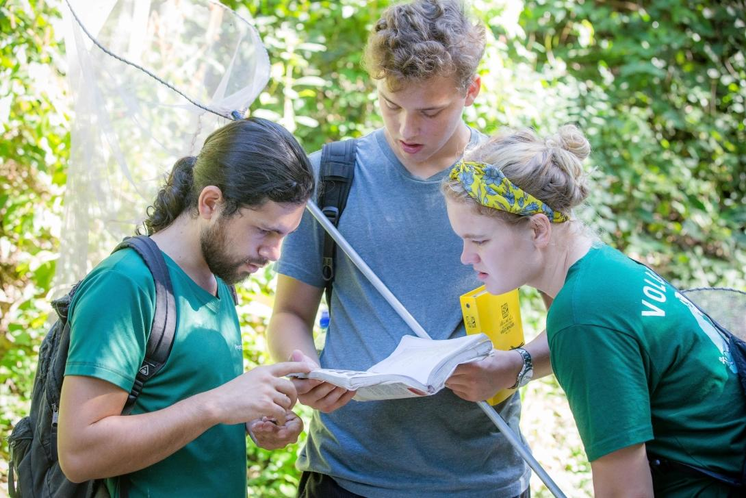 A group of college students collect scientific data for research during their Conservation internship in Costa Rica.